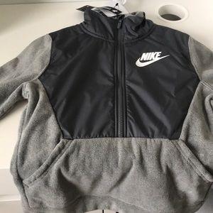 Brand new boys two pocket Nike fleece jacket.